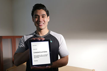Man holding decision letter on tablet