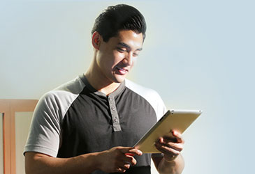 Man using application on tablet